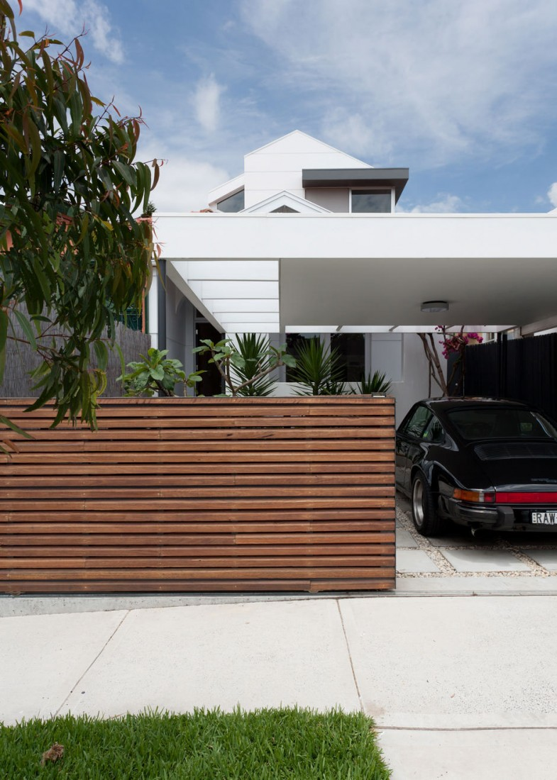 Contemporary house with modern wood fence